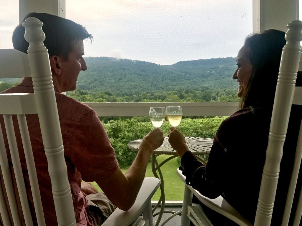 Enjoying a romantic evening on the porch at the Farmhouse at Veritas