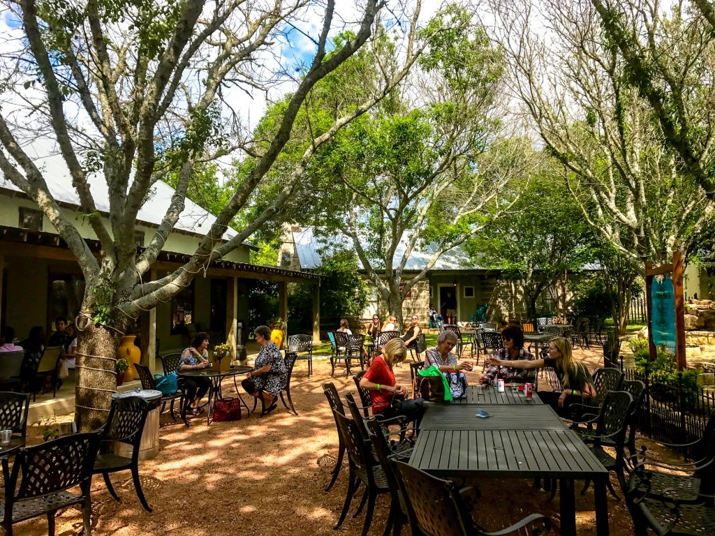 A beautiful outdoor seating area with trees providing shade at Fiesta Winery.