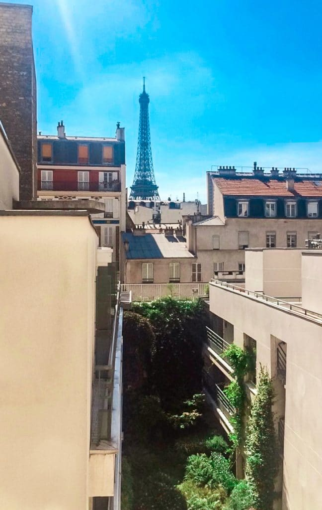 Eiffel Tower view from room of Les Jardins d'Eiffel hotel in Paris.