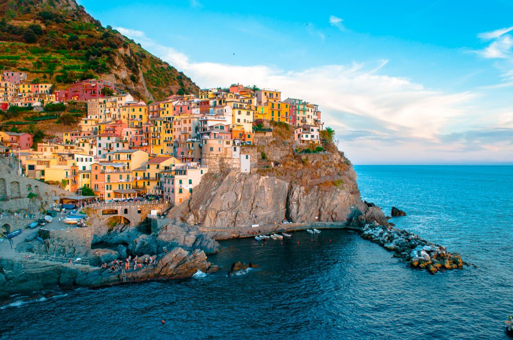 The sun hitting the colorful houses along the cliff - this city is known as Cinque Terre in Italy and a must see for anyone's Italy bucket list.