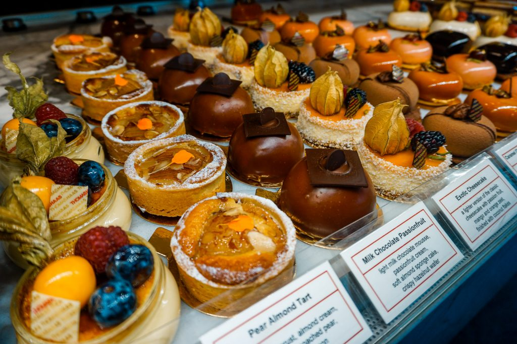 A beautiful display case of individual-sized desserts from Thomas Haas - one of the best places to eat in Vancouver.