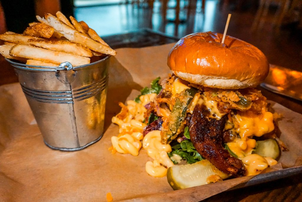 The famous and award-winning Garbage Burger with French fries from E.J. Wells Gastropub in McKinney, Texas.