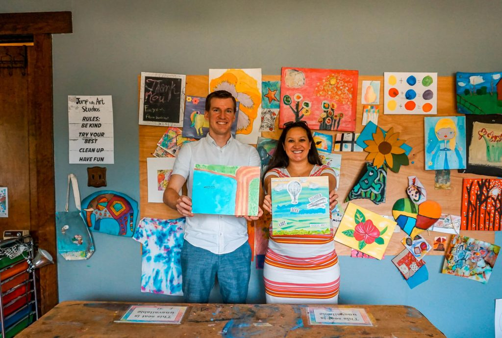 A couple showing their art canvas from Jump Into Art Studios during a romantic weekend getaway in McKinney, Texas.