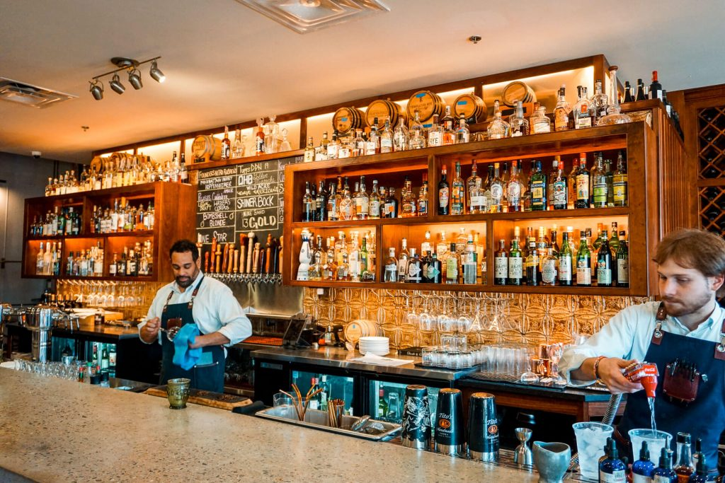 A beautiful bar with single-aged barrels, whiskey, and more at Local Yocal in McKinney, Texas.