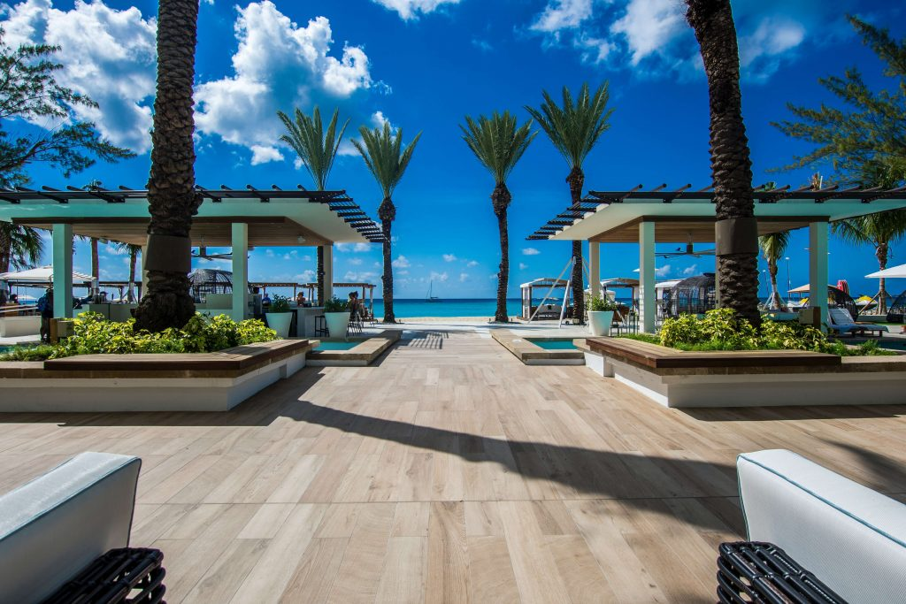 A beautiful outdoor patio with beach access from The Westin, one of the best places to stay in the Grand Cayman.
