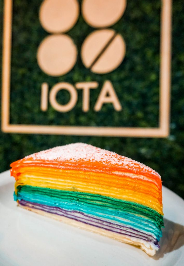 A rainbow crepe cake from Iota Brew Cafe - one of the most instagrammable desserts in Dallas.