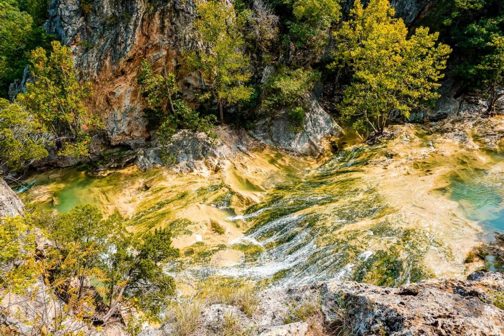 A birds-eye view of Honey Creek from rock scrambling mountains at Turner Falls Park.