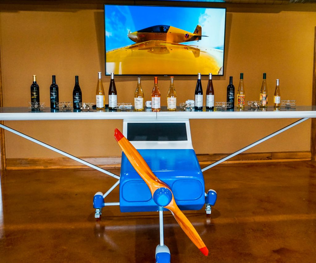 A model plane with bottles of wine on top of it from Hidden Hangar Winery & Vineyard in Denison, Texas.